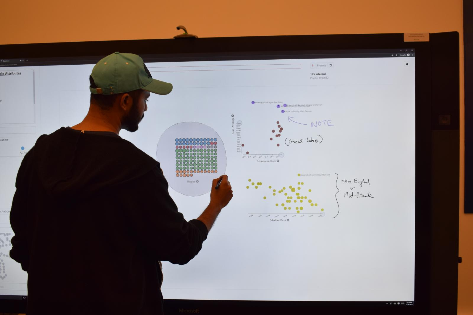 "Interacting with DataBreeze on an 84"" Microsoft Surface Hub with an external microphone placed on top of the display to record speech input."